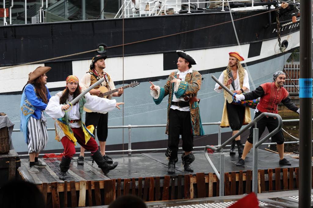 Cast members of from Caribbean Pirates at the Polly Woodside in action – from left Doru Surcel, Christina Marks, Andrew Kroenert, Jon Peck, Caspar Conrick and Lucy Gransbury in action. Image courtesy of Australian Shakespeare Company. Photographer Matt Deller.