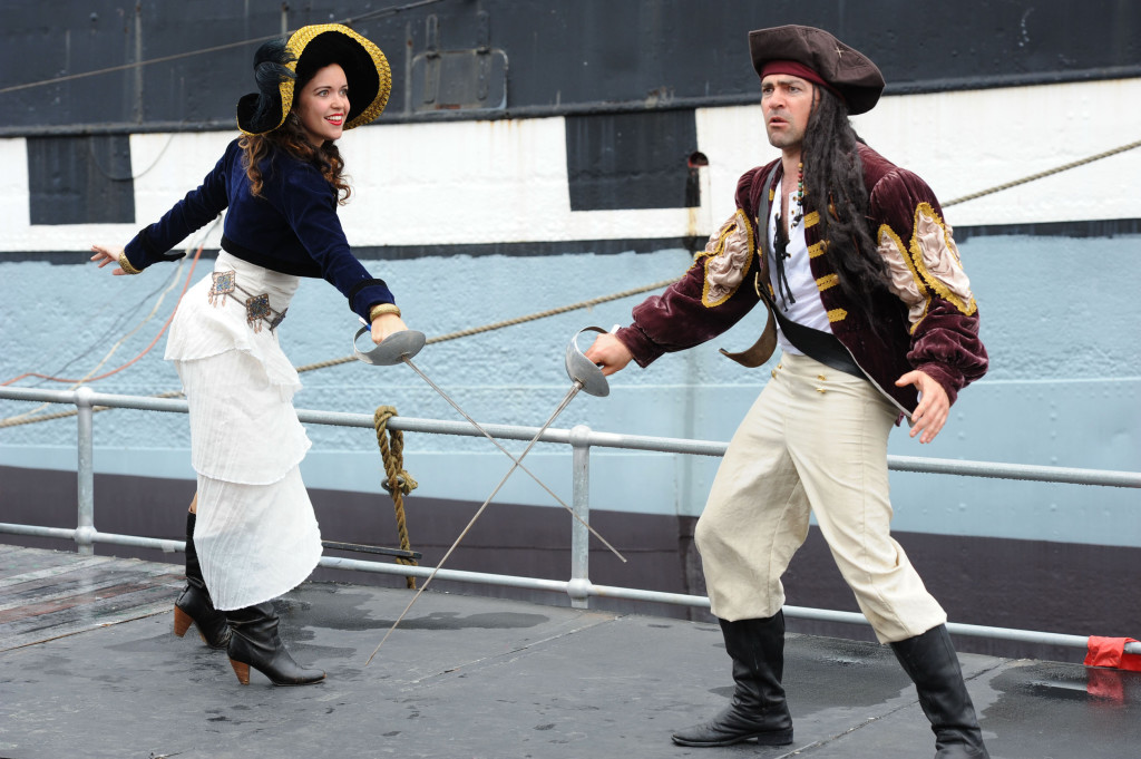 Sally (Lucy Gransbury) challenges Captain Cuthroat (Doru Surcel). Image courtesy of Australian Shakespeare Company. Photographer Matt Deller.