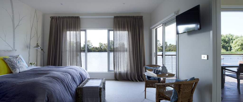The bedroom and deck at Lakeside Villas. Image courtesy of Lakeside Villas.