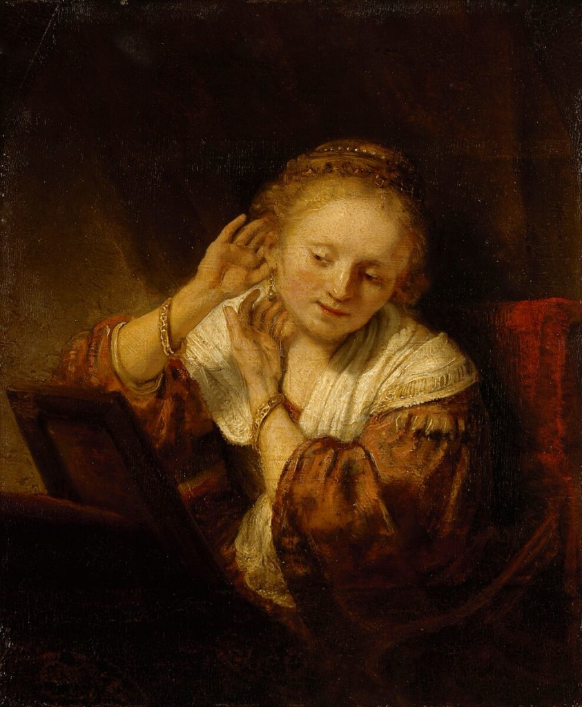 REMBRANDT Harmensz. van Rijn Dutch 1606-69 Young woman trying on earrings 1657.