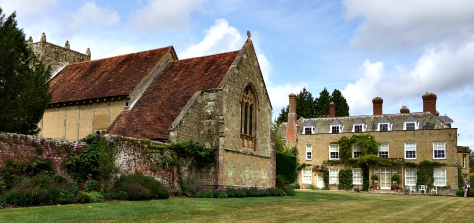 The house and church at Woolbeding Gardens.