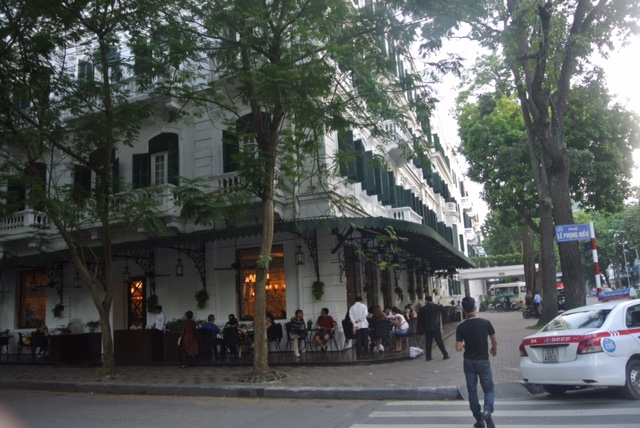 The hotel's stylish cafe is a popular destination in Hanoi's French Quarter.