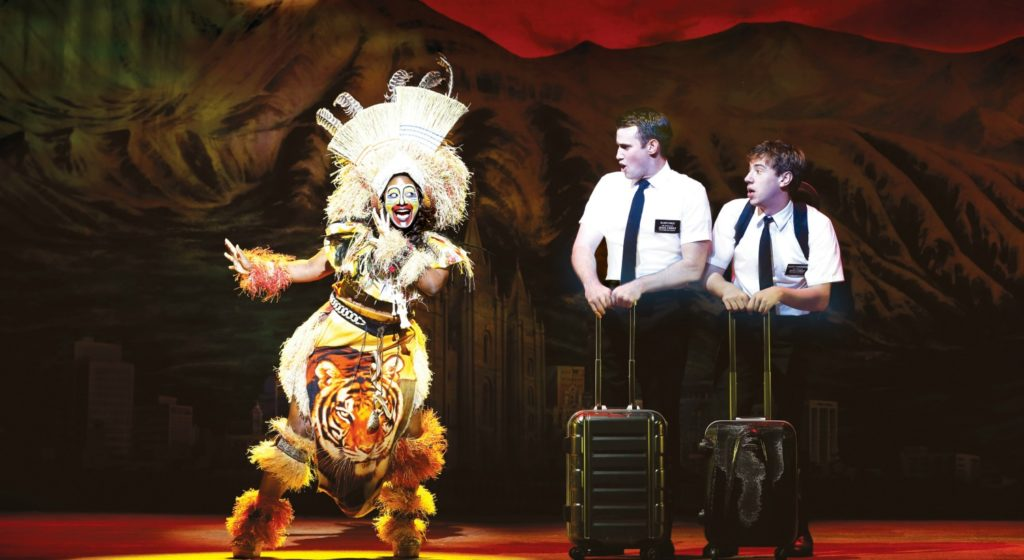 Phyre Hawkins as Mrs Brown, Ryan Bond and A.J.Holmes in the Book of Mormon. © Jeff Busby