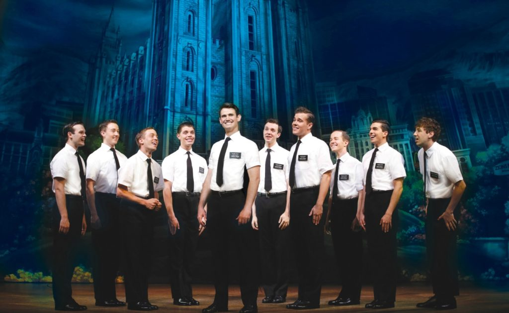 Ryan Bondy, centre, as Elder Price, A.J. Holmes, far right, as Elder Cunningham and company. © Jeff Busby