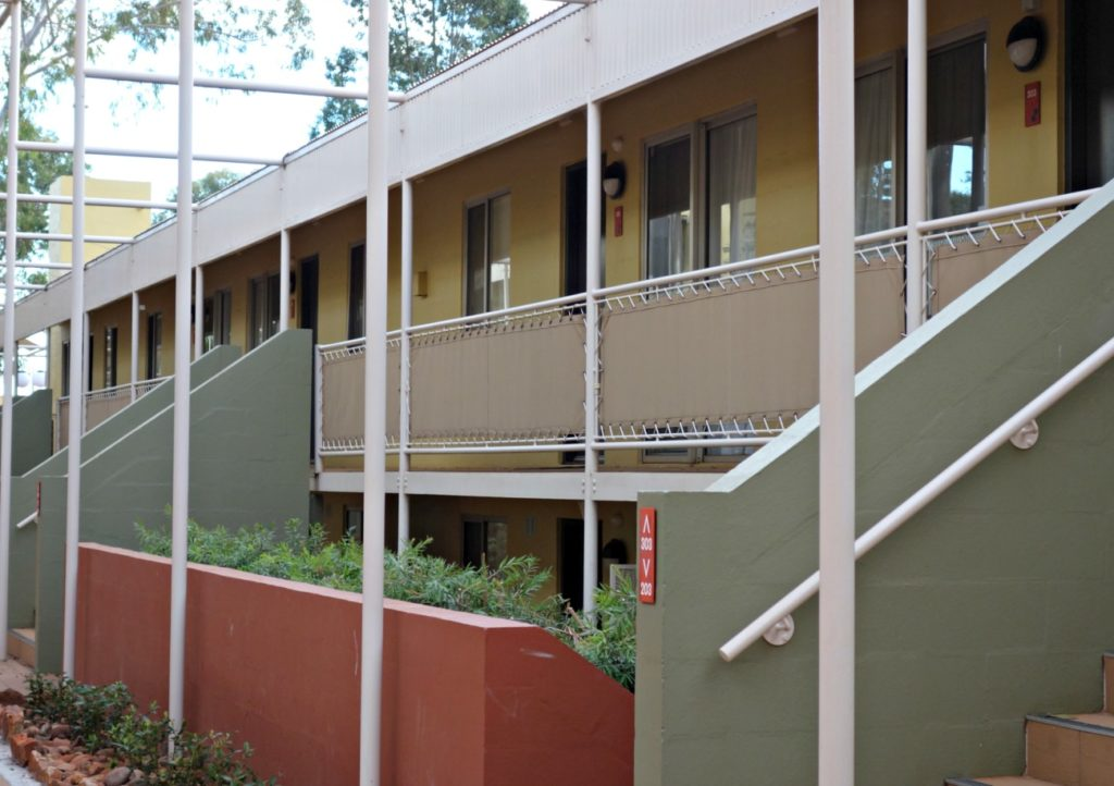 The outside view of Emu Walk apartments.