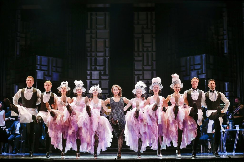 Danielle de Niese as Hanna Glawari (center) in Opera Australia's production of The Merry Widow at the Arts Centre Melbourne.