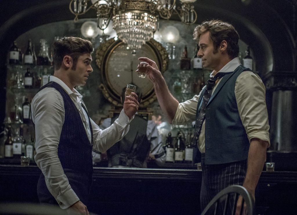 Zac Efron and Jackman in the bar scene.